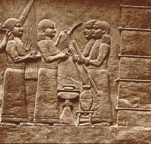 A marble slab showing the musicians and attendants of Ashurbanipal